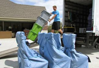 One of our long distance movers Fort Worth, unloading a truck.
