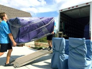 Evolution Moving FW crew, loading one of our trucks.