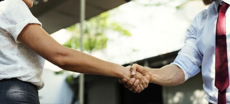 A man and a woman shaking hands.