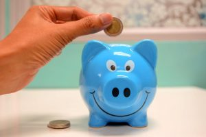 Blue piggy bank for when affordable movers Fort Worth keep my moving costs under control