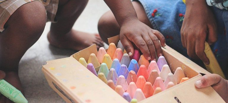 Coloring the boxes as a fun activity for kids during relocation