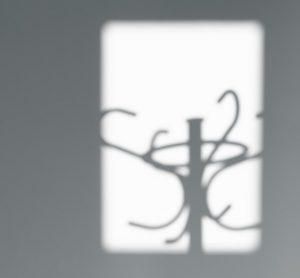 a coat rack shadow