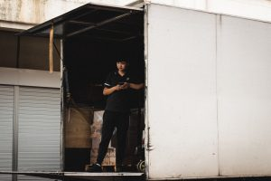 A man standing in a moving truck