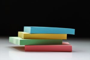 Pile of sticky notes of different colors