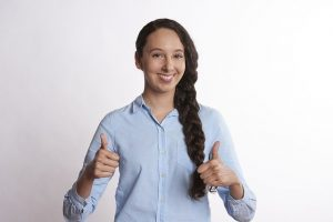Girl giving two thumbs up