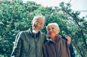 A grandpa and a grandma smiling because you're moving with parents
