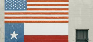 Texas and USA flags painted on a wall