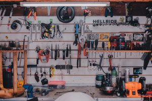 An organized garage with many tools in it