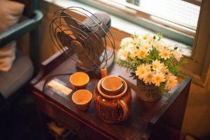 Fan, teapot, cups, flowers