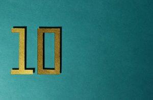 golden number ten on a teal background