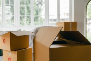 moving boxes in the room for your move from Plano to Fort Worth
