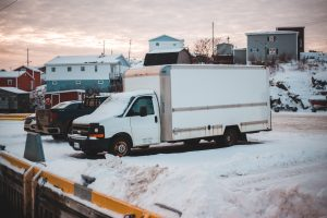 white truck on a snowy parking lot
