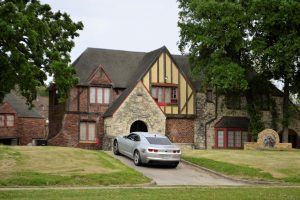 a big house with a car on the driveway