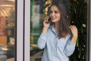 a woman talking on the phone - tasks for the night before the move