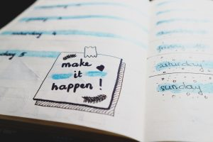 """make it happen"" sticker on the paper"