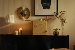 A box of books on a dresser