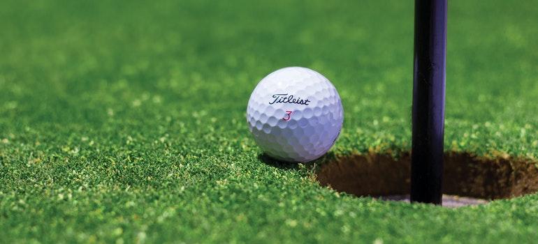 Golf ball near golf hole