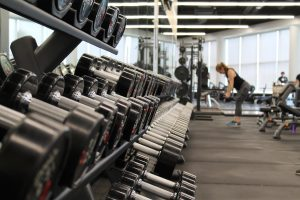 packing and moving gym equipment and dumbbells