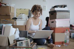 Woman writing on a laptop.
