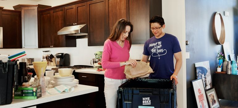 A couple searching for the items that take the longest to pack