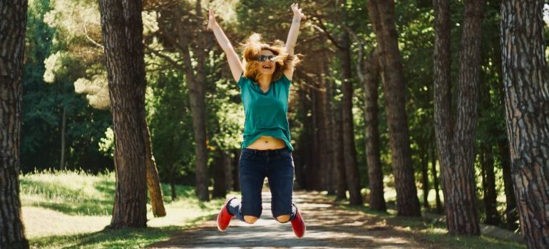 A happy woman jumping for post-moving enthusiasm