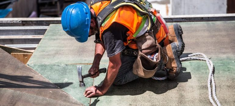 Man using a hammer.