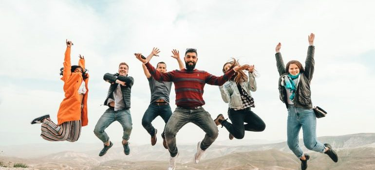 Many people jumping from happiness