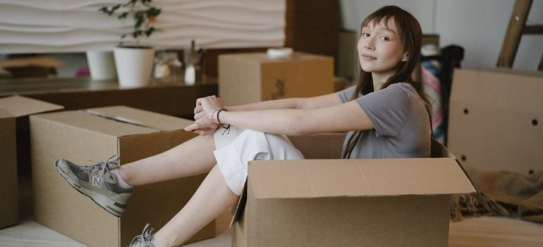 Woman sitting in a box