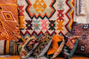 Pillows and rugs that are handmade in some of the Garland manufacturing facilities, with original patterns.