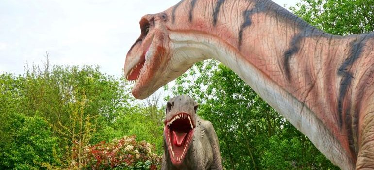 Two dinosaur figures in a park