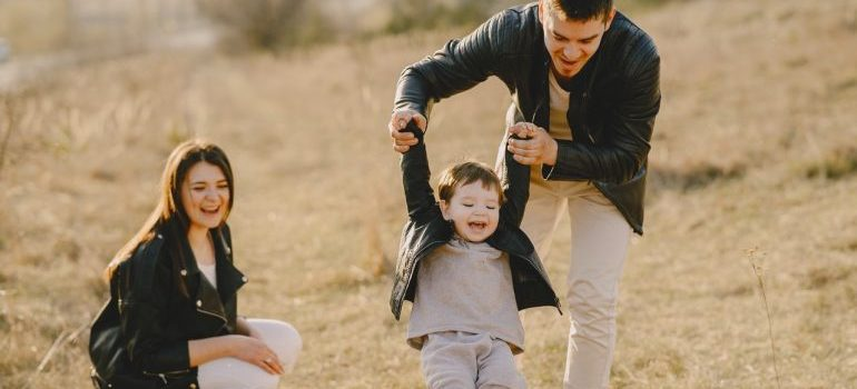 Family of 3 enjoying outsdie activities