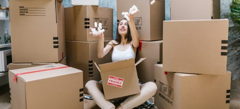 Woman holding a box in her lap